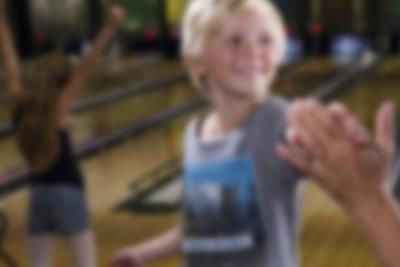 A high-five in the bowling alley at Lalandia
